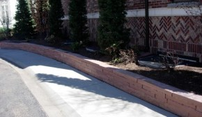 Concrete Sidewalk with Stone Planter