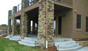 Curved Concrete and Stone Pillar Patio